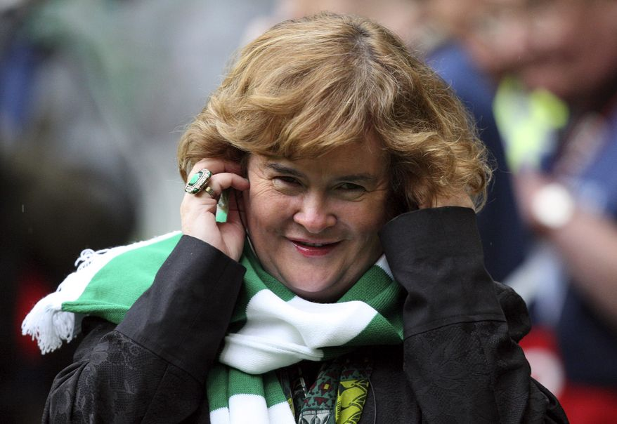 ** FILE ** British singer Susan Boyle performs ahead of the Champions League qualifying second-round soccer match between Celtic and Helsingborgs at Celtic Park in Glasgow, Scotland, on Aug. 29, 2012. (AP Photo/Scott Heppell)
