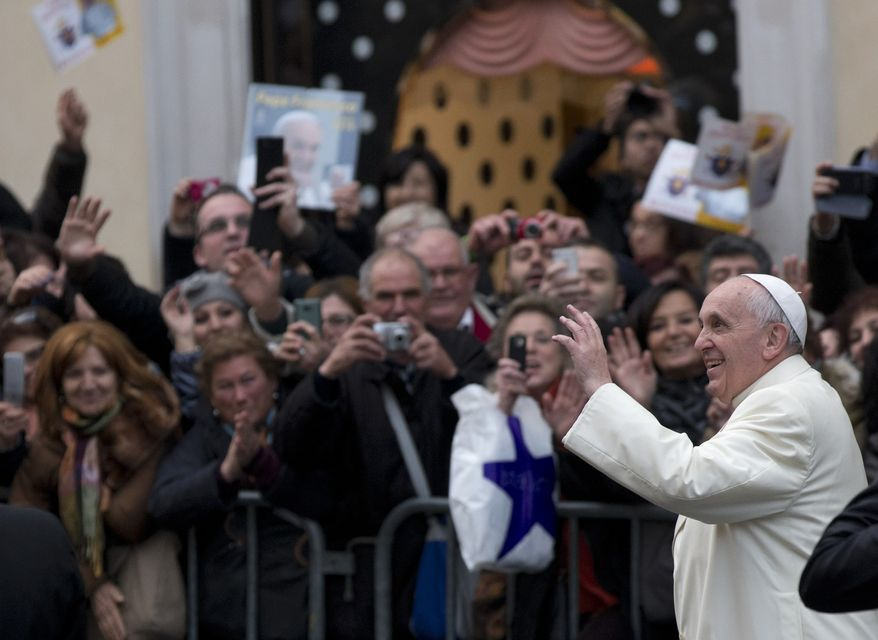 Pope Francis waves as he arrives at the Spanish Steps to pray at the statue of the Virgin Mary, in central Rome, Sunday, Dec. 8, 2013 on the occasion of the Immaculate Conception feast. (AP Photo/Alessandra Tarantino)
