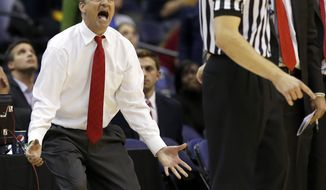 Maryland head coach Mark Turgeon, left, pleads with a referee during the second half of an NCAA college basketball game in the BB&T Classic against George Washington, Sunday, Dec. 8, 2013, in Washington. George Washington won 77-75. (AP Photo/Alex Brandon)