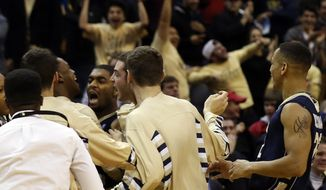 George Washington guard Maurice Creek (facing camera) celebrates with teammates after hitting the winning basket in an NCAA college basketball game in the BB&T Classic against Maryland, Sunday, Dec. 8, 2013, in Washington. George Washington won 77-75. (AP Photo/Alex Brandon)