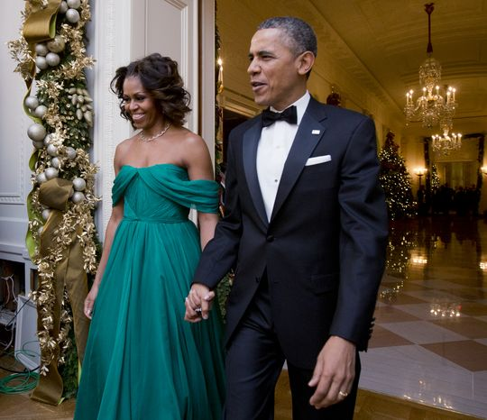 Host President Barack Obama and first lady Michelle Obama, arrive at the 2013 Kennedy Center Honors reception honoring the 2013 Kennedy Center Honors recipients, in the East Room of the White House in Washington, Sunday, Dec. 8, 2013.  (AP Photo/Manuel Balce Ceneta)