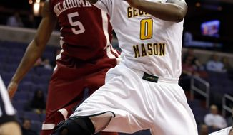 George Mason guard Bryon Allen (0) shoots in front of Oklahoma guard Je'lon Hornbeak (5) during the first half of an NCAA college basketball game in the BB&T Classic, Sunday, Dec. 8, 2013, in Washington. Oklahoma won 81-66. (AP Photo/Alex Brandon)