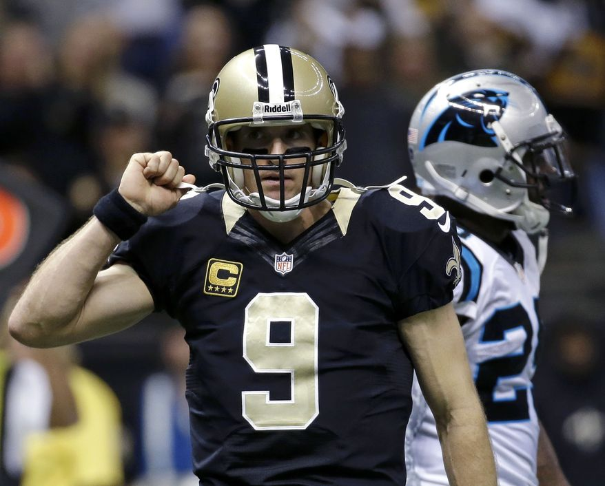 New Orleans Saints quarterback Drew Brees (9) reacts after a touchdown pass in the first half of an NFL football game against the Carolina Panthers in New Orleans, Sunday, Dec. 8, 2013. (AP Photo/Dave Martin)