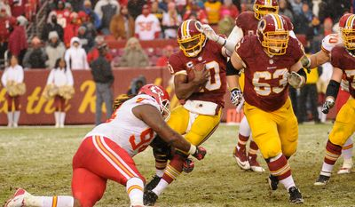 Washington Redskins quarterback Robert Griffin III (10) is sacked by Kansas City Chiefs defensive end Tyson Jackson (94) in the third quarter as the Washington Redskins play the Kansas City Chiefs at FedExField, Landover, Md., Sunday, December 8, 2013. (Andrew Harnik/The Washington Times)