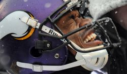 Minnesota Vikings running back Adrian Peterson reacts as he is tended to after injuring himself on a play in the first half of an NFL football game against the Baltimore Ravens, Sunday, Dec. 8, 2013, in Baltimore. (AP Photo/Gail Burton)