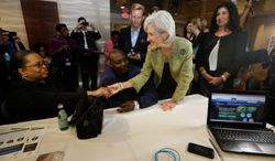 ** FILE ** Health and Human Services Secretary Kathleen Sebelius greets Mary and Willie Williams as they meet with a navigator about their health care options under the Affordable Care Act, at the North Shore Medical Center in Miami, on Tuesday, Nov 19, 2013. (Associated Press)