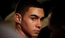 Elian Gonzalez attends an official event with Cuban President Raul Castro (not seen) in Havana on Wednesday, June 30, 2010. (AP Photo/Adalberto Roque, Pool)