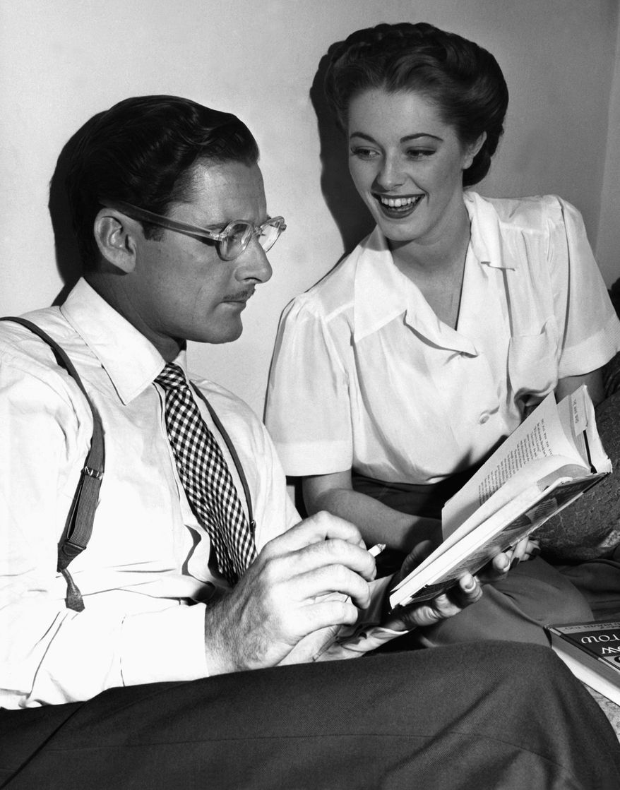 """Oscar-nominated actress Eleanor Parker, here with Errol Flynn on the set of """"Never Say Goodbye,"""" died on Monday, Dec. 9, 2013, at age 91. She played the scheming baroness in the film version of Rodgers and Hammerstein's """"The Sound of Music."""" (AP Photo)"""