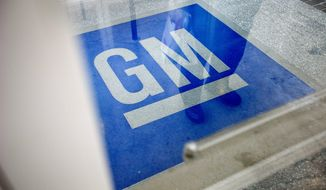 FILE - In this Thursday, Jan. 10, 2013 file photo, the logo for General Motors decorates the entrance to a former UPS facility as GM announced plans to open an information technology center in the building, in Roswell, Ga. The U.S. government ended up losing $10.5 billion on its bailout of General Motors, but still says Monday, Dec. 9, 2013 that the alternative would have been much worse. (AP Photo/David Goldman, File)
