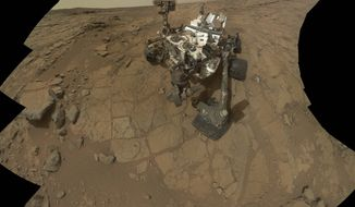 The Mars rover Curiosity, pictured here in a self-portrait, has uncovered signs of an ancient freshwater lake on the red planet that may have teemed with microbes for tens of millions of years, far longer than scientists had imagined, new research suggests. (AP Photo/NASA)