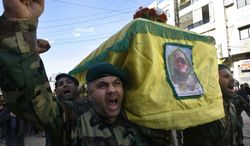 "Hezbollah fighters shout slogans as they carry the coffin of their commander Ali Bazzi, who was killed in Syria during a battle against the Syrian rebels, during his funeral procession, in the southern port city of Sidon, Lebanon, on Monday, Dec. 9, 2013. Hezbollah announced that two of its members, including a local commander, were killed while ""performing their jihadi duties."" Syrian troops captured a western town near the country's main north-south highway on Monday as the government forged ahead with a punishing offensive in a mountainous region near the border with Lebanon, state media said. (AP Photo/Mohammed Zaatari)"