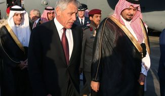U.S. Secretary of Defense Chuck Hagel, left, is greeted by Deputy Defense Minister Salman bin Sultan bin Abdulaziz, right, after he arriving at Riyadh Air Base on Monday, Dec. 9, 2013 in Riyadh, Saudi Arabia. Secretary Hagel made a brief stop in Saudi Arabia to meet with military officials and the Crown Prince.  (AP Photo/Mark Wilson, Pool)