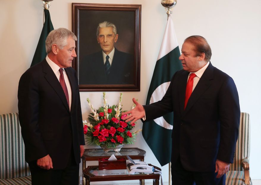 U.S. Secretary of Defense Chuck Hagel (left) and Pakistani Prime Minister Nawaz Sharif shake hands during a meeting on Monday, Dec. 9, 2013, in Islamabad. Mr. Hagel made a brief stop in Pakistan to meet with military officials and the prime minister. (AP Photo/Mark Wilson, Pool)