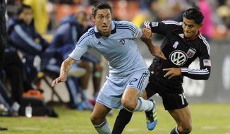 **FILE** D.C. United midfielder Andy Najar, right, battles for the ball against Sporting Kansas City's Davy Arnaud, left, during the second half of an MLS soccer game, Saturday, Oct. 22, in Washington. Kansas City won 1-0. (AP Photo/Nick Wass)