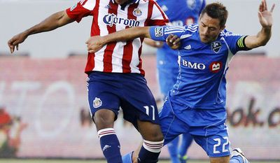 **FILE** Chivas USA's Juan Agudelo (11) and Montreal Impact's Davy Arnaud (22) fight for the ball in the first half of an MLS soccer game in Carson, Calif., Wednesday, June 20, 2012. (AP Photo/Jae C. Hong)