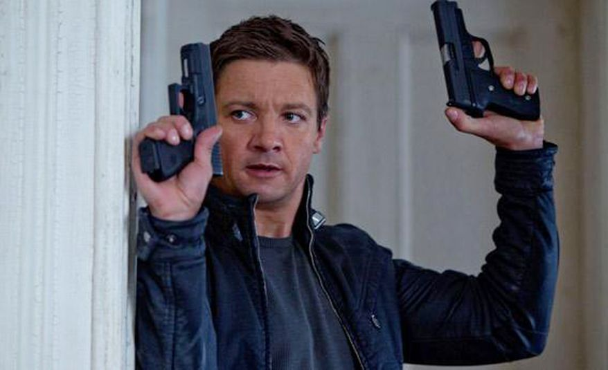 Jeremy Renner in The Bourne Legacy with his Sig-Sauer P229 handgun.