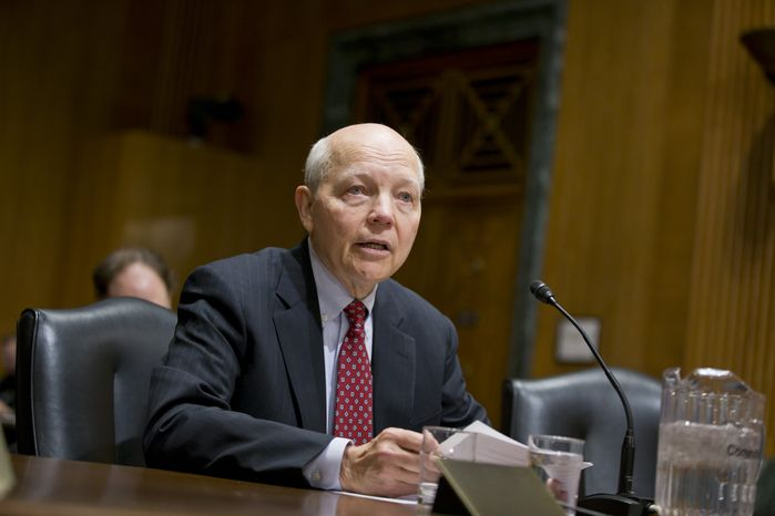 John Koskinen, President Barack Obama's choice to head the Internal Revenue Service (IRS) testifies on Capitol Hill in Washington, Tuesday, Dec. 10, 2013, before the Senate Finance Committee hearing on his nomination. Koskinen, 74, is a retired corporate and government off