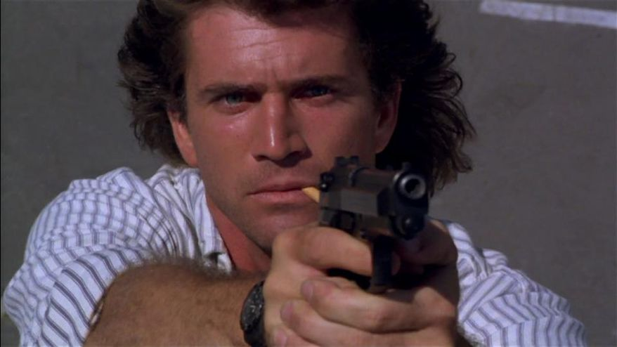 """Actor Mel Gibson in his role as Beretta-toting LAPD Detective Martin Riggs in the """"Lethal Weapon"""" series."""