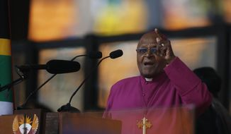 Retired Anglican Archbishop Desmond Tutu speaks at the memorial service for former South African president Nelson Mandela at the FNB Stadium in Soweto near Johannesburg, Tuesday, Dec. 10, 2013. (AP Photo/Matt Dunham)
