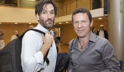 ** FILE ** In this photo taken on May 24, 2012, Spanish reporters Javier Espinosa, right, and Ricardo Garcia Vilanova, left, pose for a photo during the ceremony of the Miguel Gil journalisms awards in Barcelona, Spain. Spanish newspaper El Mundo says one of its reporters and a freelance photographer are being held hostage in Syria by a group linked to al Qaeda. (AP Photo/Joan Borras)