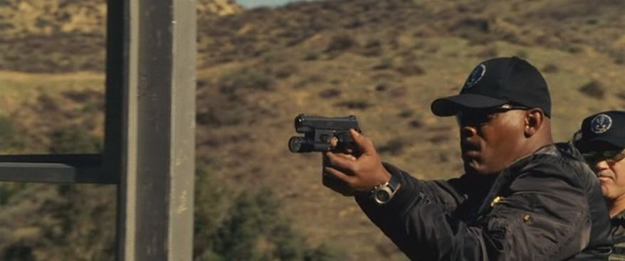 """Samuel L. Jackson's character in the movie """"S.W.A.T."""" wields a Kimber handgun"""