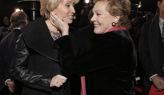 "Actresses Emma Thompson (left) and Julie Andrews attend the U.S. premiere of the film ""Saving Mr. Banks"" on Monday, Dec. 9, 2013, in Burbank, Calif. (Todd Williamson/Invision/AP)"