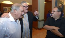 Former Atlanta Braves manager Bobby Cox, left, Pittsburgh Pirates manager Clint Hurdle, center, and former Orlando Magic head basketball coach Stan Van Gundy share a laugh at Baseball's winter meetings in Lake Buena Vista, Fla., Tuesday, Dec. 10, 2013. Cox was elected to the Hall of Fame on Monday. (AP Photo/Phelan M. Ebenhack)