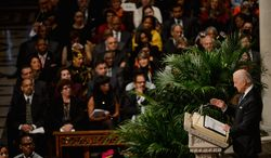 """Vice President Joseph R. Biden recalls warmly his meeting with Nelson Mandela in South Africa during Wednesday's national memorial service for the former South African president at the Washington National Cathedral. """"So many places in the world need the spirit of Nelson Mandela,"""" Mr. Biden said. (andrew harnik/the washington times)"""