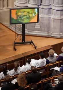 A video of former South African President Nelson Mandela is shown during a memorial service Wednesday for the anti-apartheid icon at the National Cathedral in Washington. (associated press)