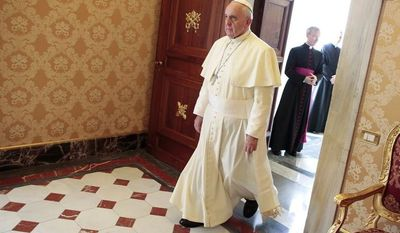 Pope Francis arrives to welcome Republic of Congo President Denis Sassou N'Guesso on the occasion of their private audience in the pope's library at the Vatican, Monday, Dec. 9, 2013. (AP Photo/Tony Gentile, pool)
