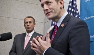 House Budget Committee Chairman Rep. Paul Ryan, R-Wis., right, accompanied by House Speaker John Boehner of Ohio, left, takes reporters' questions as during a news conference on Capitol Hill in Washington, Wednesday, Dec. 11, 2013, as House Republicans signaled support for a budget deal worked out yesterday between Ryan and Senate Budget Committee Chair Sen. Patty Murray, D-Wash. The budget deal was one of a few major measures left on Congress' to-do list near the end of a bruising year that has produced a partial government shutdown, a flirtation with a first-ever federal default and gridlock on President Obama's agenda. (AP Photo/J. Scott Applewhite)