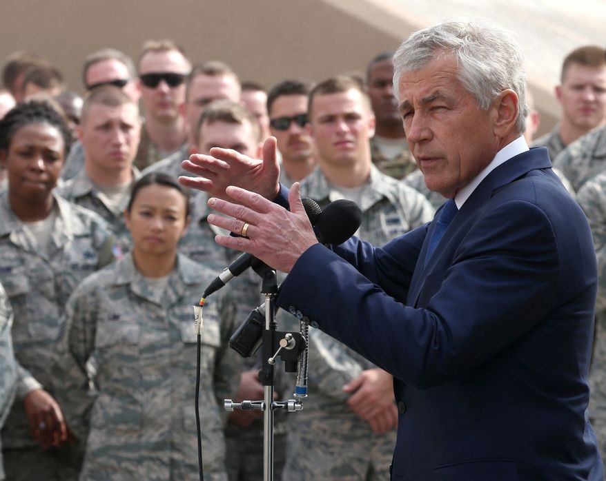 In this Tuesday, Dec. 10, 2013 photo,  U.S. Secretary of Defense Chuck Hagel, speaks with troops at the Al Udeid air base in Qatar. Hagel ended his six day trip in Qatar, meeting with the Emir, military officials, and visiting with US Troops stationed there. (AP Photo/Mark Wilson, Pool)