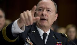 """National Security Agency (NSA) Director Gen. Keith Alexander testifies on Capitol Hill in Washington, Wednesday, Dec. 11, 2013, before the Senate Judiciary Committee hearing on """"Continued Oversight of U.S. Government Surveillance Authorities"""" .      (AP Photo/Manuel Balce Ceneta)"""