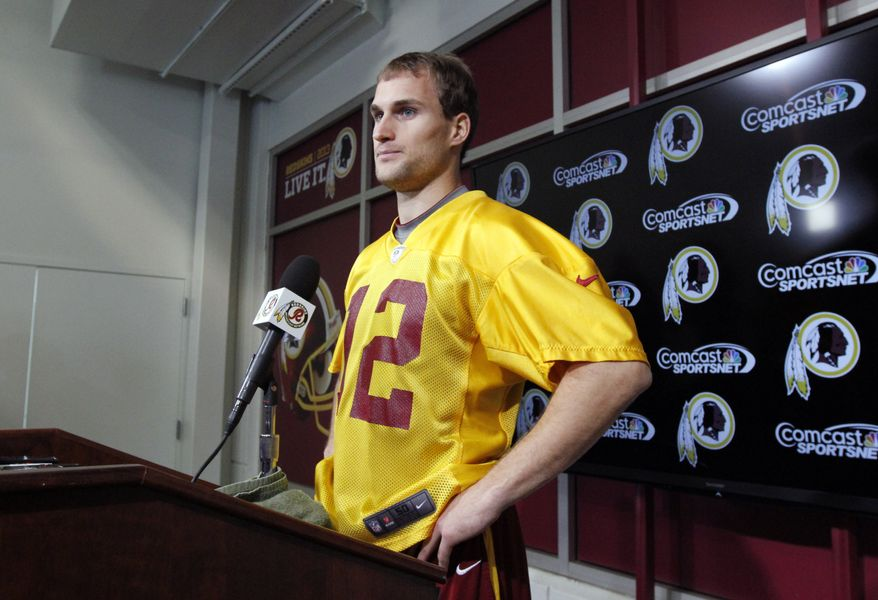 Washington Redskins quarterback Kirk Cousins pauses before speaking at a media availability at their NFL football training facility, Wednesday, Dec. 11, 2013, in Ashburn, Va. Cousins will start for the Redskins on Sunday, and Robert Griffin III will be the No. 3 quarterback behind Rex Grossman. (AP Photo/Alex Brandon)