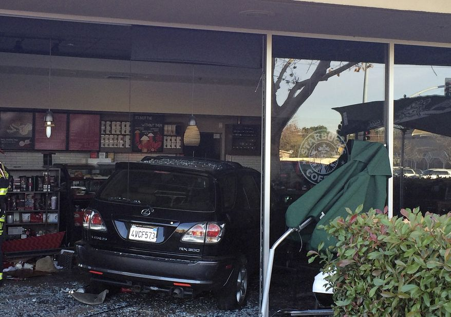 In this photo taken Tuesday, Dec. 10, 2013, and released by the Folsom Police Department, show the damage after a Lexus SUV plowed into a Starbucks shop in Folsom, Calif. Police say eight people were injured, one seriously, after the driver of the car had parked and was trying to adjust the position of her vehicle when she accelerated into the store. The driver and a passenger in the vehicle were not injured. (AP Photo/Folsom Police Dept.)