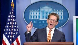 """All in a day's work: White House press secretary Jay Carney praises former President George W. Bush's paintings (""""I think the results are pretty impressive"""") and wrangles with skeptical press over transparency issues. (Associated Press)"""