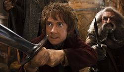 "Martin Freeman (left) as Bilbo Baggins joins a quest to reclaim an ancient homeland in ""The Hobbit: The Desolation of Smaug."" John Callen plays the character Oin. (WARNER BROS. PICTURES VIA ASSOCIATED PRESS)"