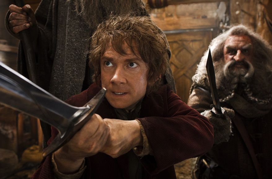 """Martin Freeman (left) as Bilbo Baggins joins a quest to reclaim an ancient homeland in """"The Hobbit: The Desolation of Smaug."""" John Callen plays the character Oin. (WARNER BROS. PICTURES VIA ASSOCIATED PRESS)"""