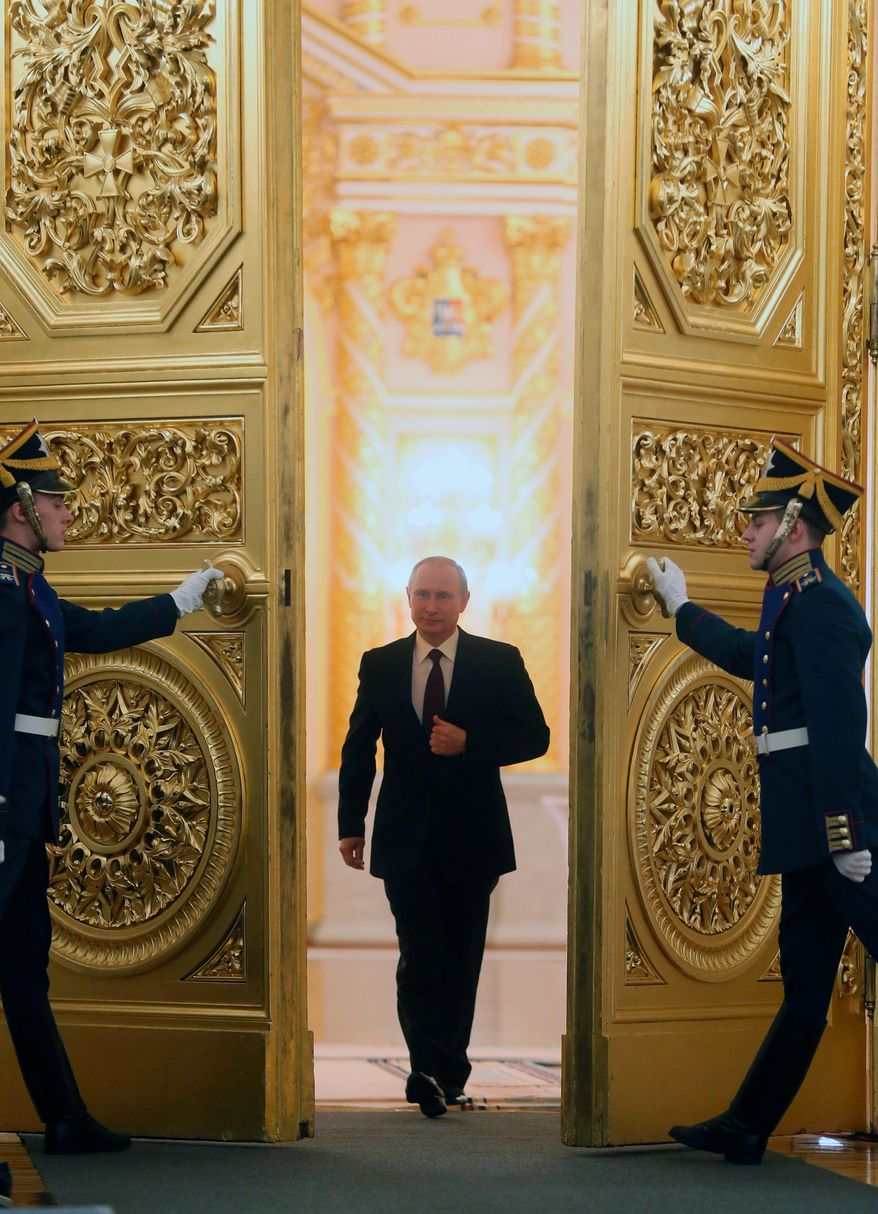 PUTIN'S POWER PLAY: Russian President Vladimir Putin, delivering his annual state of the nation address, lodges veiled insults at the U.S. as Moscow tries to retain power over former Soviet states. (Associated Press)