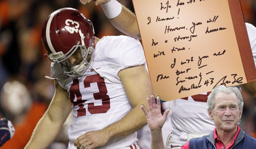 Alabama quarterback AJ McCarron (10) consoles kicker Cade Foster (43) after he missed a field goal against Auburn during the first half of an NCAA college football game in Auburn, Ala., Saturday, Nov. 30, 2013. (AP Photo/Dave Martin)