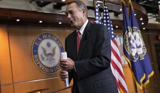 House Speaker John Boehner of Ohio leaves a news conference on Capitol Hill in Washington, Thursday, Dec. 12, 2013, where he vehemently rebuked conservative groups who oppose the pending bipartisan budget compromise struck by House Budget Committee Chairman Rep. Paul Ryan, R-Wis., and Senate Budget Committee Chair Sen. Patty Murray, D-Wash. Boehner said the GOP leadership has had enough tea party-driven intransigence in Congress and he doesn't care what they think. (AP Photo/J. Scott Applewhite)