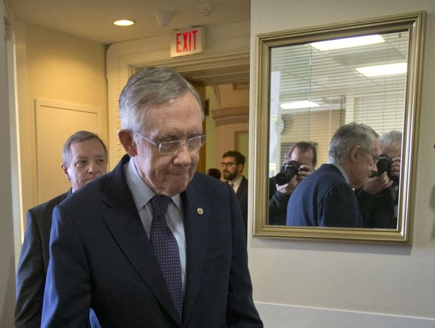 Senate Majority Leader Harry Reid of Nev., right, followed by Senate Majority Whip Richard Durbin of Ill., arrive for their news conference on budget, Thurs