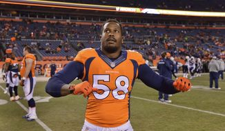 Denver Broncos outside linebacker Von Miller (58) stretches before playing against the San Diego Chargers in an NFL football game, Thursday, Dec. 12, 2013, in Denver. (AP Photo/Jack Dempsey)