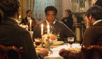 "This film publicity image released by Fox Searchlight shows Chiwetel Ejiofor in a scene from ""12 Years A Slave."" The film was nominated for a Golden Globe for best motion picture drama on Thursday, Dec. 12, 2013.  The 71st annual Golden Globes will air on Sunday, Jan. 12.  (AP Photo/Fox Searchlight Films, Jaap Buitendijk)"