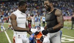 FILE--In this Oct. 20, 2013 file photo, Cincinnati Bengals wide receiver A.J. Green, left, and Detroit Lions wide receiver Calvin Johnson exchange jerseys after their NFL football game in Detroit.  Johnson takes the shirt off his back _ literally _ after some games to swap jerseys with an opponent. Johnson said he usually knows ahead of time when he's going to make a postgame trade, and doesn't plan to do it after Monday night's game against the Baltimore Ravens. (AP Photo/Jose Juarez, file)