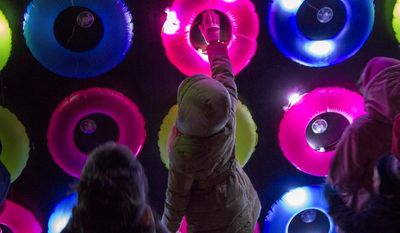 """""""We love to see the reactions of people when they realize they can play with the installations,"""" Ms. Alvarez says about the """"Floating Lights"""" display."""