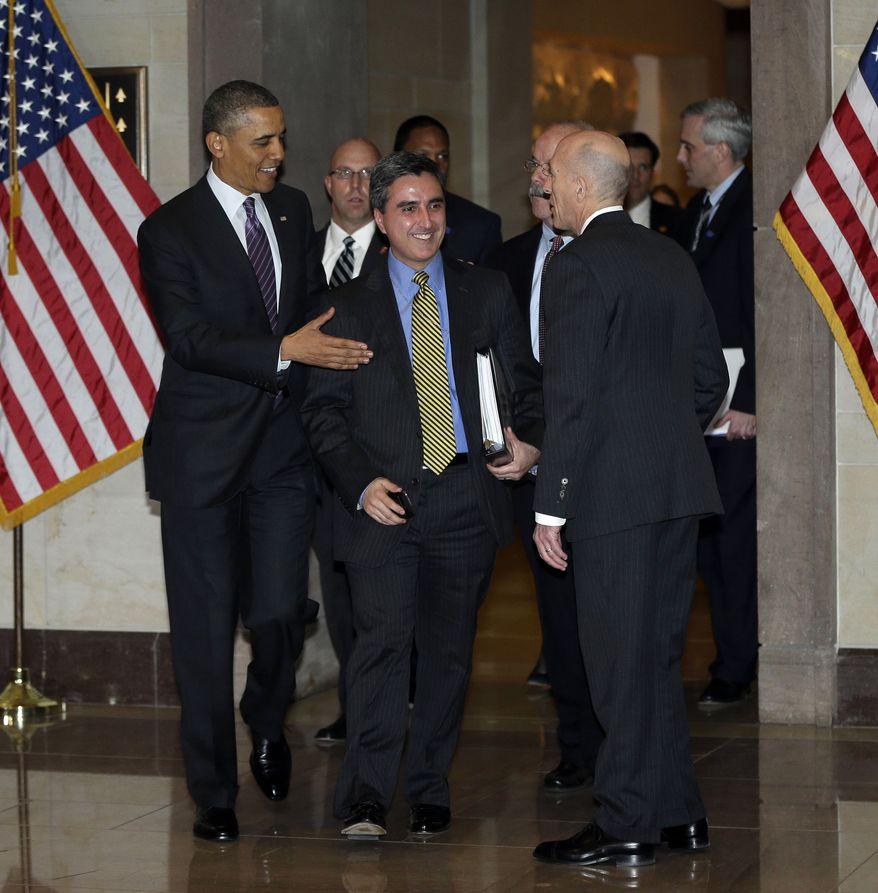 **FILE** President Obama (left), and his director of legislative affairs, Miguel Rodriguez (center), are greeted by the House Sergeant Arms Paul Irving after being escorted by escorted by Senate Sergeant at Arms Terry Gainer, on Capitol Hill to meet with House Democratic Caucus in Washington, on March 14, 2013. (Associated Press)