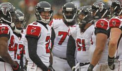 Atlanta Falcons quarterback Matt Ryan huddles up with the offense during an NFL football game against the Green Bay Packers Sunday, Dec. 8, 2013, in Green Bay, Wis. (AP Photo/Matt Ludtke)