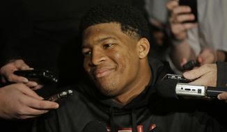 Heisman Trophy finalist Jameis Winston, quarterback at Florida State, talks to  reporters during an informal media availability, Friday, Dec. 13, 2013, in New York. (AP Photo/Julio Cortez)