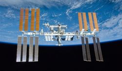 In this image provided by NASA the International Space Station is shown with the backdrop of Earth. The image was photographed by an STS-132 crew member on space shuttle Atlantis after the station and shuttle began their post-undocking relative separation on May 23, 2010. The astronauts aboard the International Space Station dimmed the lights, turned off unnecessary equipment and put off science work Thursday Dec. 12, 2013 as NASA scrambled to figure out what's wrong with one of two identical cooling loops that shut down Wednesday. (AP Photo/NASA)